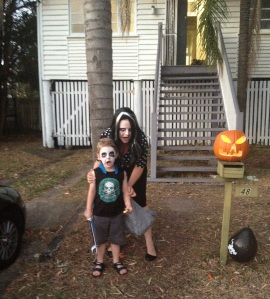 Max and I being zombies next to last year's Jack'o'lantern.